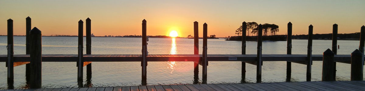 From Pillar to Post, a Dock Can't Stand without Support and Connection. Sunset West, Perdido Key, Florida.