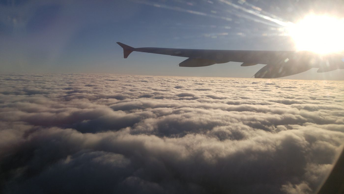 Airplane above the clouds wings